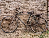 An antique bicycle. An old bicycle in the rural area Royalty Free Stock Image