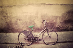 Old bicycle in a rustic street in Florence Royalty Free Stock Images