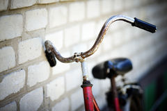 The old bicycle. Rusty from time costs near a wall stock image