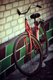 The old bicycle. Rusty from time costs near a wall stock photos