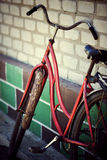 The old bicycle. Rusty from time costs near a wall royalty free stock photo