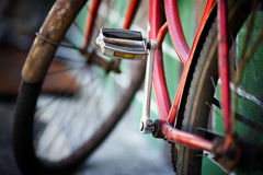 The old bicycle. Rusty from time costs near a wall royalty free stock image