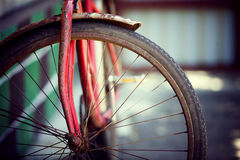 The old bicycle. Rusty from time costs near a wall royalty free stock images