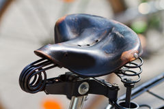 Old bicycle saddle Stock Image