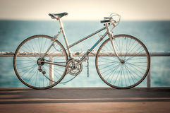 Old bicycle at sea side Stock Photos