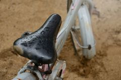 The old bicycle seat. The old bicycle seat with raindrops Royalty Free Stock Image