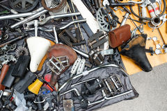 Old bicycle spare parts and accessories in heap Stock Image