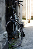 Old bicycle standing on the street Stock Images