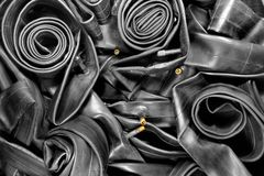 Old bicycle tire tubes. Old black bicycle tire tubes stock photo
