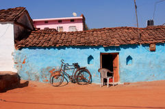 Old bicycle in traditional indian village. Old bicycle and traditional indian village house at the sunny day stock photos