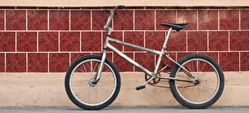 Old Bicycle on a Wall Stock Photography