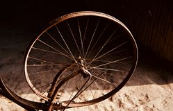An old bicycle wheel ring unique photo. A round shape old ring with spokes of a bicycle unique photo royalty free stock image