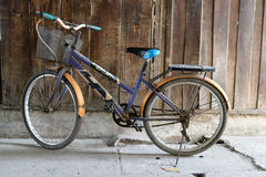 Old bicycle and wooden wall in the market Royalty Free Stock Images