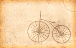 Old bicycle with wooden wheels  Added Old paper texture. Royalty Free Stock Photo