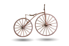 Old bicycle with wooden wheels isolated with clipping path Stock Photo