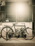Old bicycle on wooden window house wall Royalty Free Stock Photos