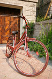 Old bicycle in yard Stock Images