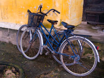 Old Bicycles. Against Crumbling Building in Hoi An, Vietnam Royalty Free Stock Image