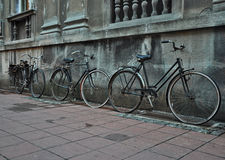 Old bicycles. Three old bicycles leaning against the wall Royalty Free Stock Images