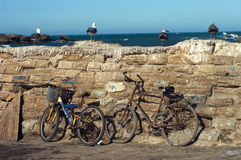 Old bicycles in Essaouira, Morocco. Old bicycles standing near the wall in Essaouira, Morocco Stock Photos