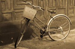 Old bicycles in sepia tone. An Old bicycles parking in the shade, sepia filter effect Royalty Free Stock Photography