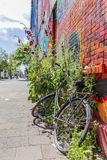 An old bicyle parked next to a graffiti wall Royalty Free Stock Photography