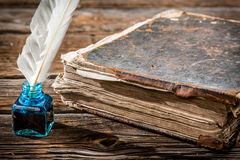 Old big book and pen with blue ink Stock Image