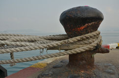 Old big cleat with ropes to hold a ship Stock Images