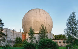 Old big dome of a radar antenna on the roof of the building of a Russian military base Stock Photography