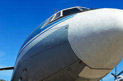 Old big plane on a background of blue sky. Big aircraft on a background of blue sky Royalty Free Stock Photos