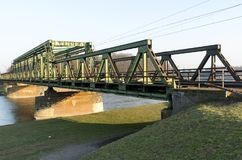 Old steel railway bridge, green and big stock images