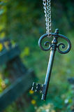 Old big sunlit key with chain. And old big sunlit key held with a chain Royalty Free Stock Images