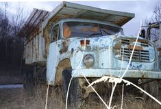 An old and big truck or car, with alot of rust stock photo