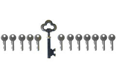 Old big vintage forged key standing out from the crowd Royalty Free Stock Photos