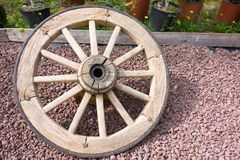 Old big wooden wheel for the cart Royalty Free Stock Images