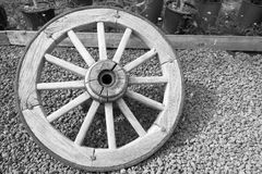 Old big wooden wheel for the cart Stock Photo