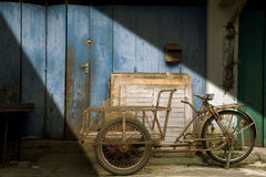 Old Bike. A old time bike standing by a building Royalty Free Stock Photography