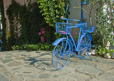 Old bike. Old blue bicycle for garden and street decoration Stock Photos