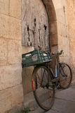Old bike. Near a door on the isle of mallorca Royalty Free Stock Photo