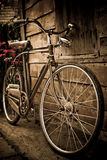Old bike against Stock Image