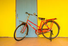 Old bike. Against the wall at home Royalty Free Stock Image