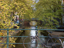Old Bike. In Amsterdam canal stock photos