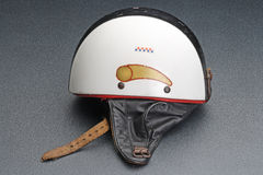 Old bike crash helmet. Old racing motorbike crash helmet, in the fifties and sixties Stock Images