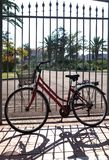 Old bike at the fence. Royalty Free Stock Photos