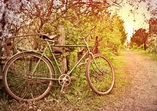 Old bike at the fence. village Street Stock Photo