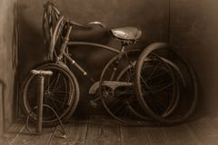 Old bike fix service with pump on wooden floor Royalty Free Stock Image