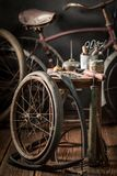 Old bike fix service with wheels, tools, and rubber patch. On dark background stock photography