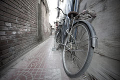 Old bike lying in Beijing hutong Stock Photos