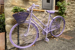 Old bike painted lilac at lerma, Italy Stock Photography