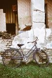 Old bike parked at the farmhouse royalty free stock images